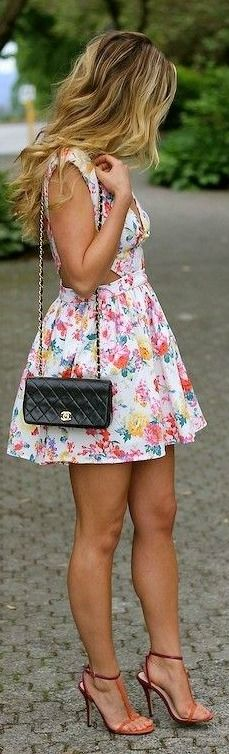 Flirty floral dress with adorable side cut-outs. Such a girly style!