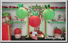 From Schoolgirl Style: use paper lanterns with hot glued leaves as apples to hang from the ceiling