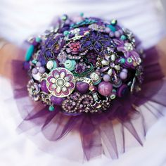 Carry A Non-Traditional Bouquet    Are you not a flower girl? Wayne had a jewelry-loving bride who created a dazzling bouquet out of a clutch of multi-colored brooches.        Photo Credit: Evan Guston Photography