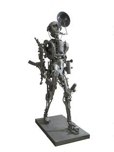 Willie Bester - Universal Soldier - 2000 - Scultura in metallo - 5 x 55 x 270 African Art, Metallica, Bookends, Sculpture, Studio, Decor, Africa Art, Decoration, Sculptures