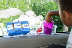 Shower caddy attached to car window for toy storage on long journeys