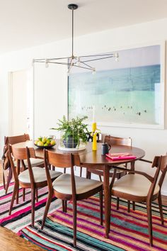 Henderson paired a vintage Danish modern dining table with a colorful rug from Lake in Silver Lake, a Max Wanger print and a pendant by Bren...