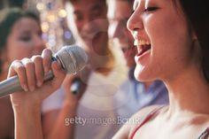 Close-up of young woman singing at karaoke