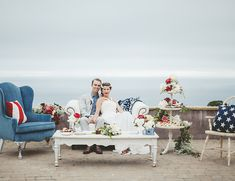 chic 4th of July wedding with vintage furniture, american flag pillows, and an ocean view