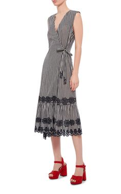An elegant summer piece, this **Suno** dress features a black and white gingham print with floral embroidery in a flattering wrap silhouette.
