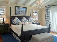 A Blue, Floral Fabric Ties This Coastal Bedroom Together While A  Traditional, Wood Bed