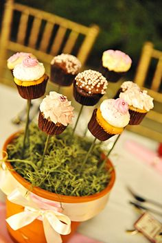 A bouquet of cupcakes works double-duty as a sweet centerpiece and a creative dessert display.