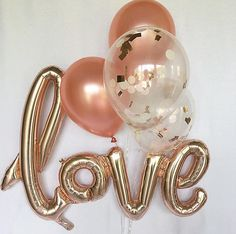 Welcome to Oh How Charming!  This listing is for:  This listing is for (1) jumbo 40 inch AIR FILL ONLY rose gold love script self sealing balloon. A straw to inflate and string to hang as a banner are included  (2) rose gold and (2) clear blush pink, ivory and rose gold mylar confetti 11 latex balloons  ~ Balloons ship flat & deflated ~ Clear Balloons are pre-stuffed with 1 circle blush pink and ivory tissue confetti (rose gold is mylar shreds) ~ Latex Balloons can be filled with air or h...