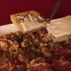 """Dinner #3 of the week long money saving meat S-T-R-E-T-C-H-I-N-G chicken. Tonight's meal is a beautiful Middle Eastern Shredded Chicken and Chick Pea Stew served with a size of homemade mozzarella """"cheeze"""" foccacia . #eggfree #top8free #yumo #soyfree #daiya #dinner #dairyfree #foodallergies #glutenfree #glutenfreelife #glutenfreeisnotafad #hearty #Healthy #homemadefromtheheartallergyfr #celiac #nutfree #MiddleEasternInspired #kingarthurflour #earthbalancebutter by…"""