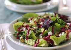 Mixed green salad with goat cheese , pistachios and beet vinaigrette
