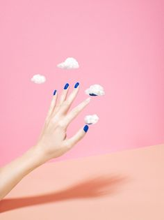 Justin Fantl —the hand itself is not distorted, but there are tiny clouds surrounding it that are removing the nail polish. they're like floating cloud cotton balls.