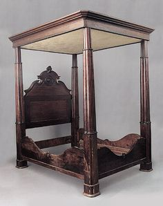 A Louisiana Mahogany Full Tester Bed, mid-19th c., the stepped and molded tester frame above a pedimented headboard, the cluster columned posts joined by shaped stretchers, height 104 in., width 69 in., depth 86 in. SEE PHOTO PAGE 39.