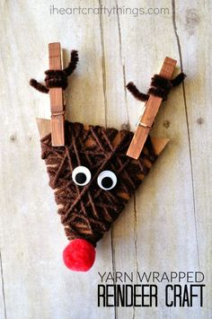 This cute yarn wrapped reindeer craft is a fun Christmas kids craft and makes for great fine motor work for kids. #christmasartsandcraftsforkids,