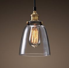 The clear glass cloche pendant ($99) from Restoration Hardware displays Edison-style filament bulbs for a cool, vintage look. Hang it above rustic wooden furniture to match the antique style.