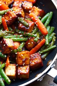 Sesame Ginger Tofu and Veggie Stir Fry  - Loaded with so much flavor and completely  vegetarian friendly! #tofustirfry #stirfry #veggiestirfry | Littlespicejar.com