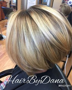 Dana deepened this client's base color for a natural shadow root. She then applied Goldwell color to add warm lowlights, and added a few brighter highlights around the client's face. She finished the look with bob hairstyle.  Hair color and design by Dana