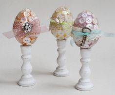 These button covered eggs started with the plastic ones, and have lace and charms added.
