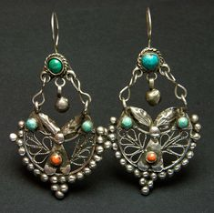 Afghanistan | Antique earrings; silver, coral, and turquoise. From the Kuchi people | 96€