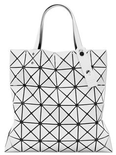 This open tote bag features triangles placed on lined mesh fabric that, when  carried, takes unique shape and character. Catherine Reed · Issey Miyake 736f1d9f28