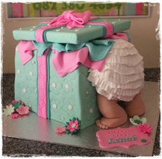 My friend sent me a photo of the baby leaning over into a box cake. The person that posted it was just an admirer not the baker/decorator so she can't help me. My daughter is expecting a baby and I thought this would be the perfect cake for her...
