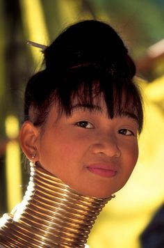 """karen tribe, thailand ~ I saw a program about this practice. One girl allowed them to take the coil off. She was colder without it and instead of """"stretching her neck"""" they found that hit had actually lowered her shoulders and caused a bad deformity. She had the coils put back on. So sad."""