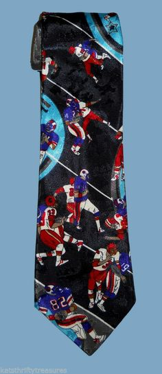MMG Brand Necktie Features an American Football Players Novelty Print on a Black Background. Made in the USA.