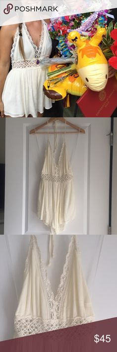 White Halter Romper Stolen Hearts Halter Romper  • Beautiful creamy off white color  • Elegant Lace along waist and neck line • Halter style neck line • Zipper back  • Purchased at an amazing little boutique in Waikaloa, Hawaii • Worn once, no flaws • Size medium can also fit a small for a flowing style fit  Excellent pre loved condition, worn once for a graduation ceremony. Bundle discount: 15% off 2 or more items. No trades ✨ Free $5-$7 item with this purchase, simply tag me in the item…