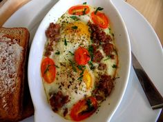 brunch: baked egg, sausage, cherry tomatoes