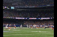 Louisville Cardinals playing against Florida Gators at the Allstate Sugar Bowl