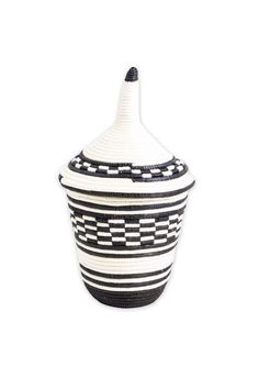 "Craftswomen in Rwanda use time-old tradition to weave carefully dyed sisal fibers and sweet grass into stunning one-of-a-kind pieces rich in cultural meaning and purpose. - 8.5"" tall and 5.5"" wide - M"