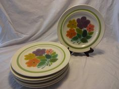 """Just in time for Spring, this beautiful floral pattern is lively and colorful and begging for a dinner date. Purple, mustard, orange, pink and greens are featured in this pattern. Produced by Franciscan in the late 60s and early 70s.  Measures 10.25"""" wide.  We have 6 of these in minty condition (this listing) and 5 more that have flaws (4 with cracks, one chipped, all are functional and visibly great)."""