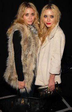 OLSENS ANONYMOUS BLOG MKA MARY KATE AND ASHLEY OLSEN FASHION STYLE BLOG FUR VEST COAT RED LIPS DENIM HEREMES BAG GOLD SNAKE CLUTCH EMERALD GOLD RING