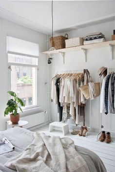 tiny house decorating inspiration - rolling rack and open shelving for when there is no closet. minimalist and modern storage idea.