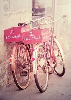 A pair of pretty pink bikes.