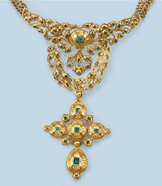 Wow! AN ANTIQUE EMERALD DEVANT DE CORSAGE The openwork front designed as step-cut emerald set flowers and festoons, supporting an emerald set cross pendant with foliate engraving at the reverse, to a modern necklace composed of four chains, possibly Spanish, 18th Century