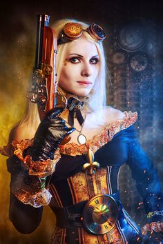 Steampunk beauty wearing goggles with one eye embellished by the workings of time.  Dressed with elaborate details in metal & carrying a sawed-off shot gun in her off the shoulder gown.