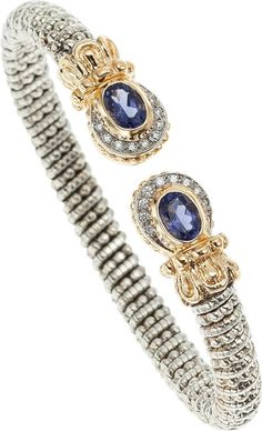 AN IOLITE, DIAMOND, GOLD, STERLING SILVER BRACELET, ALWAND VAHAN. The bracelet features oval-shaped iolite