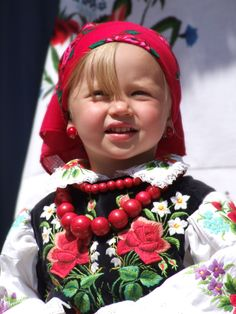 Cute little Polish girl dressed in Łowiczanka folk costume. Łowicz is a town in central Poland