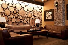 sliced tree trunks wall. Easy to hang art on, just nail in. Circles break up the squareness. Maybe on back wall by bathrooms. More