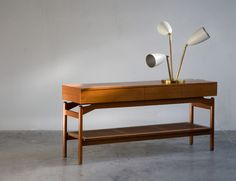 Sideboard in walnut with cane shelf and tab