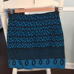 Turquoise Patterned mini Size SM (looks more like xs) mini. Purchased on Thread up and listed as Urban Outfitters, but there isn't a tag that indicates as such. Would be super cute with black tights! 15 inches from top to bottom, 12 inches across @ waist, 17 inches accords at bottom. Skirt has some stretch to it though. Skirts Mini