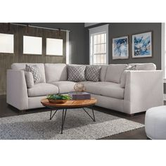 The 821 Hawthorne Stationary Sectional is a chic, contemporary sectional with reversible seat and back cushions with lovely graphic design accent pillows.  This group offers the addition of a swivel chair and pouf ottoman.  We are most excited about the option of a Hidden USB Charging Port.