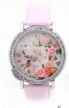 Reloj miniaturas en relieve.