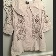 Luii Anthropologie Ivory Flower Jacket Medium Great jacket by Luii (Anthropologie).  Size medium.  Ivory with large cutout flowers in a grayish brown color.  Button front with Peter Pan type collar.  Sleeves are 3/4 length. Anthropologie Jackets & Coats