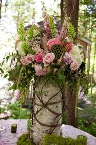 rustic centerpiece.  Love the bark vase with hanging amaranthus, roses, scabiosa, bells of ireland, and moss