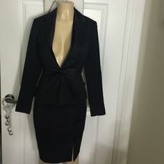 White House Black Market Stunning Black Bow Suit 2 Worn once in perfect condition White House Black Market suit with bow. The bow on the jacket is removable. Stunning suit! Comes with garment bag. White House Black Market Jackets & Coats Blazers