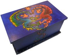 This is an handcrafted and hand painted trick puzzle box featuring beautiful Dragon in Love story. Description from brilliantpuzzles.com. I searched for this on bing.com/images