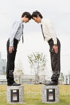Businessmen bowing royalty-free stock photo