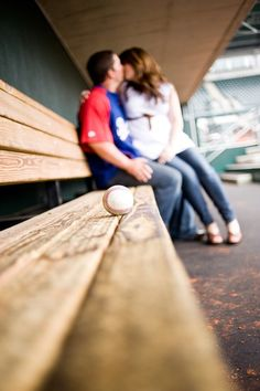 What a cute baseball engagement picture this would be! Just write the date on the ball!!