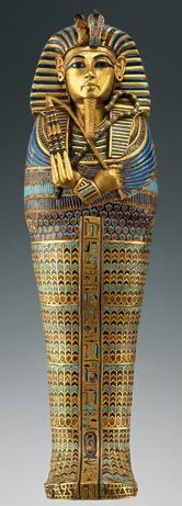 Coffin for Tutankhamun's Viscera  Rendered in gilded wood and faience, this coffin was specifically designed to hold King Tutankhamun's mummified internal organs, which were believed to be essential equipment for the afterlife.